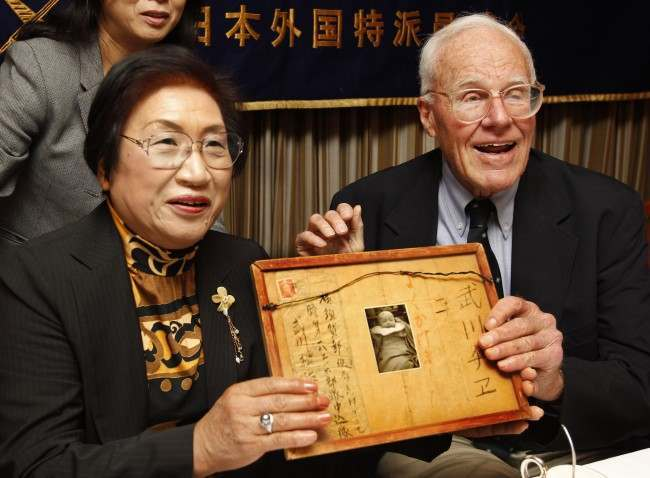 ormer U.S. soldier fighting on Iwo Jima during the World War II, Franklin Hobbs, right, and Chie Takekawa, whose father was killed in the same battle, hold a framed letter and a photo of her sister during a press conference at the Foreign Correspondents Club of Japan in Tokyo, Thursday, Oct. 28, 2010. The faded photograph of a baby Japanese girl and colorful drawing of an air raid drill were quietly stored away in the home of Franklin Hobbs III. As a 21-year-old American GI fighting on Iwo Jima, one of the bloodiest battles of World War II, Hobbs found them in the chest pocket of a fallen Japanese soldier and took them home as a souvenir.
