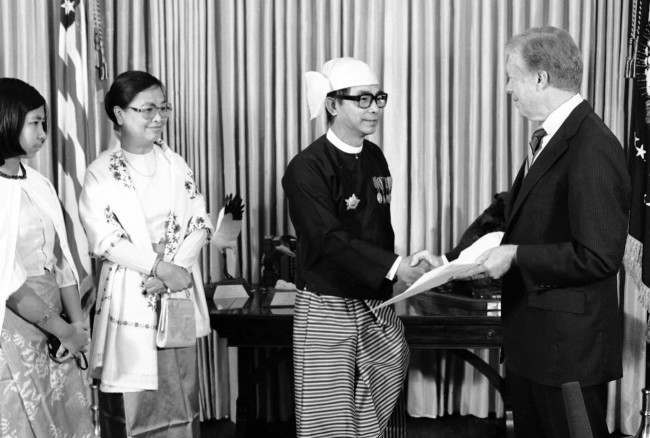 President Jimmy Carter, right, accepts credentials at the White House in Washington from the Socialist Republic of the Union of Burma's Ambassador U Kyaw Khaing, Nov. 24, 1980.