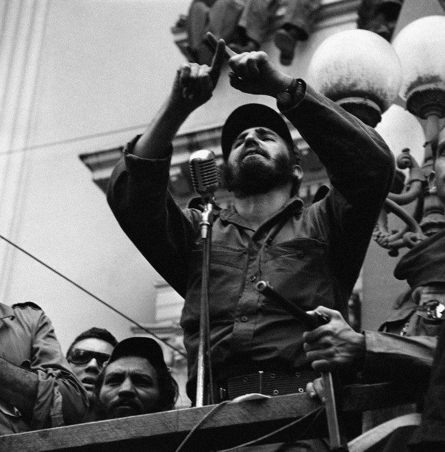 Rebel Leader Fidel Castro makes a cross with his fingers and swears that he will be true to the faith the people have placed in him as he addresses huge crowd in Santa Clara, Cuba Jan. 7, 1959. Castro and his forces are enroute to the capital city of Havana.