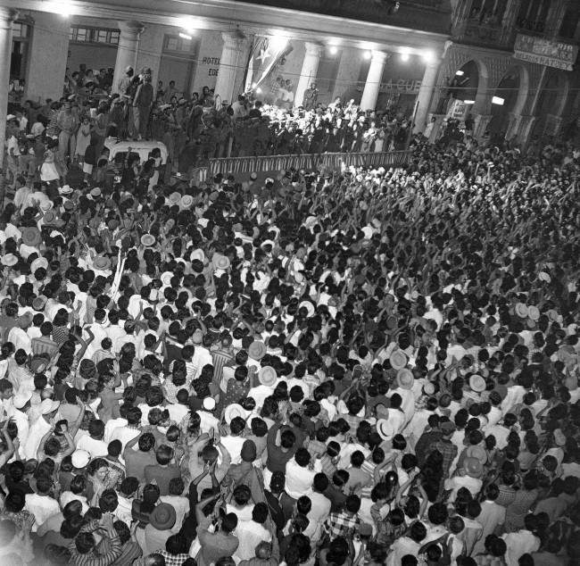 his was the scene in the town square as Fidel Castro, Cuba's rebel leader was given a thunderous welcome when he made his appearance at a rally at 3 a.m. in Manzanillo, Cuba, Feb. 4, 1959. The rebel leader was scheduled to appear about 8 p.m. but extra stops en route delayed his arrival. The crowd stayed on and packed the square for the early morning visit.