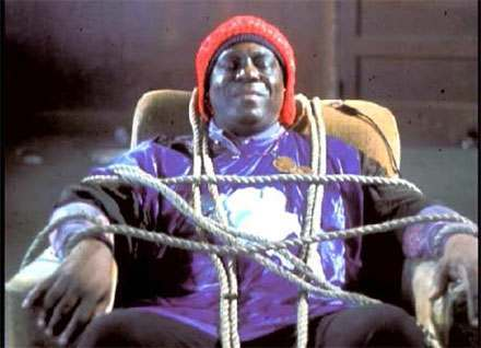 Sun-Ra  still from 'Space is the Place' film - 1972 Ra has been kidnapped by the CIA to  gain information on the propulsion system for his music-driven spaceship.