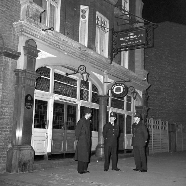 Police are pictured outside the Blind Beggar Public House, Whitechapel Road. PA/PA Archive/Press Association Images