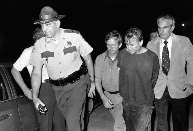 James Earl Ray, right, is escorted by Brushy Mountain State Prison Warden Stonney Lane following his capture in the rugged country near Petros, Tennessee, June 13, 1977.