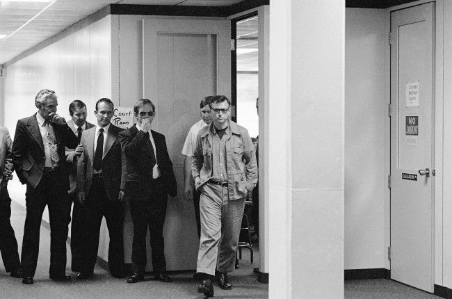 James Earl Ray, who is serving a 99 year sentence for the death of Dr. Martin Luther King, Jr., walks from the court room at Wartburg, Tennessee on Oct. 27, 1977, where is was being tried for escape. Ray was found guilty and given a sentence of one to two years on Thursday.