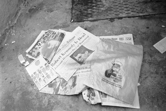 Newspapers, paper bag and an air travel guide which were found in the bed room of the Pax Hotel, where a man identifying himself as Ramon George Sneyd, are lying near a dust bin outside the hotel in Pimlico, London on June 10, 1968. The proprietor of the hotel, Mrs. Anna Thomas said that Ramon George Sneyd lived in her hotel from June 5 to June 8. Ramon George Sneyd was arrested at London's airport on June 8 for carrying a false passport and a loaded gun. United States Assistant Attorney General is, seeking a speedy extradition for the man believed to be James Earl Ray, the accused assassin of Dr. Martin Luther King. James Earl Ray had a preliminary hearing in court and was remanded in custody without bail until June 18.