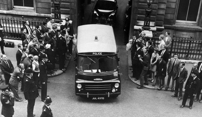 A Police van carrying Ramon George Sneyd, leaves Bow Street court in London, England on June 18, 1968, after the hearing. Ramon George Sneyd, said by American Police to be James Earl Ray, wanted for questioning in connection with the shooting of Dr. Martin Luther King, has been remanded in custody until June 27 when extradition proceedings will be heard. The hearing of the two British charges possession of a forced passport and a firearm and ammunition, without a certificate would be adjourned until the end of the extraction application.