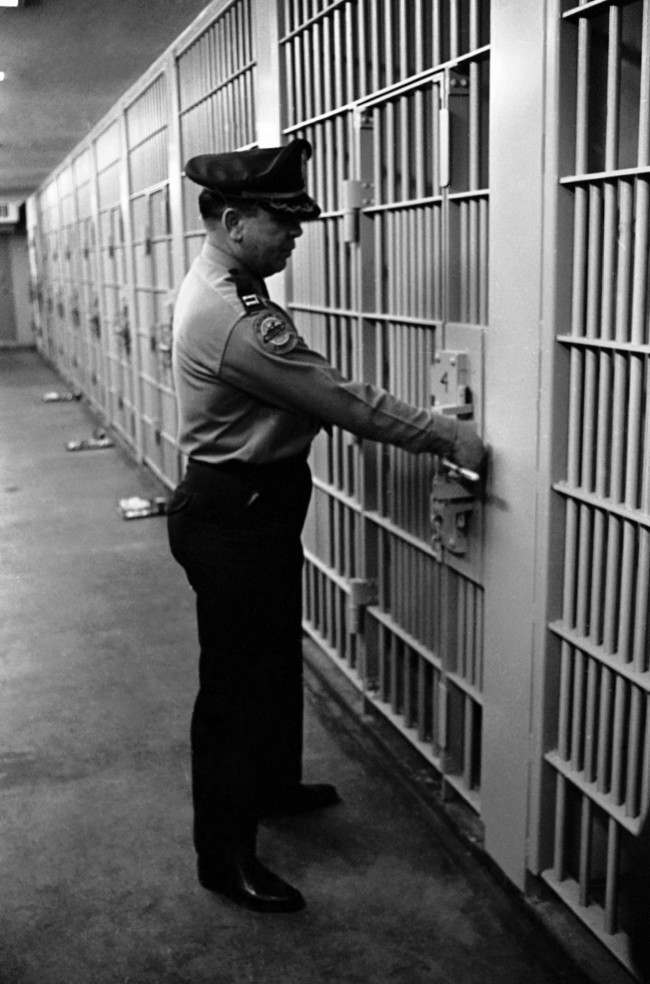 Captain Bobby Robertson checks door of James Earl Ray's cell in the maximum security building of the Tennessee State Prison in Nashville, Tennessee on March 11, 1969.