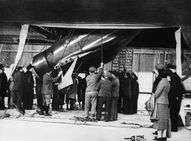 Members of the crew of the Hindenburg are unloading the plane of Jimmy Haizlip in Frankfurt, Germany on June 1, 1936 which was freighted to Germany on the Hindenburg's second flight from the United States.