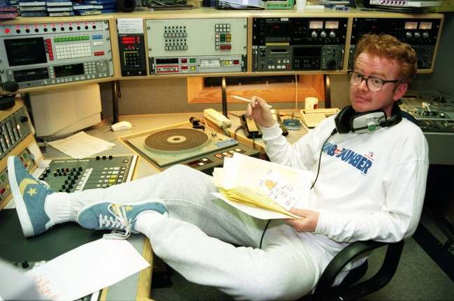 """Radio One DJ Chris Evans in the studio of BBC RAdio One sherer he started his first day of hosting the """"Breakfast Show"""". * 21/9/95 He was named most stylish man of the year. * 22/12/1995 Returned to the airwaves after failing to turn up yesterday for his early-morning show. Officially absent due to a throat infection, a festive meal on Wednesday with his production team had developed into a bit of a session which ended with Evans incapable of presenting Radio One's flagship show. He now faces a carpeting from BBC chiefs, but today he merely joked the whole event off."""