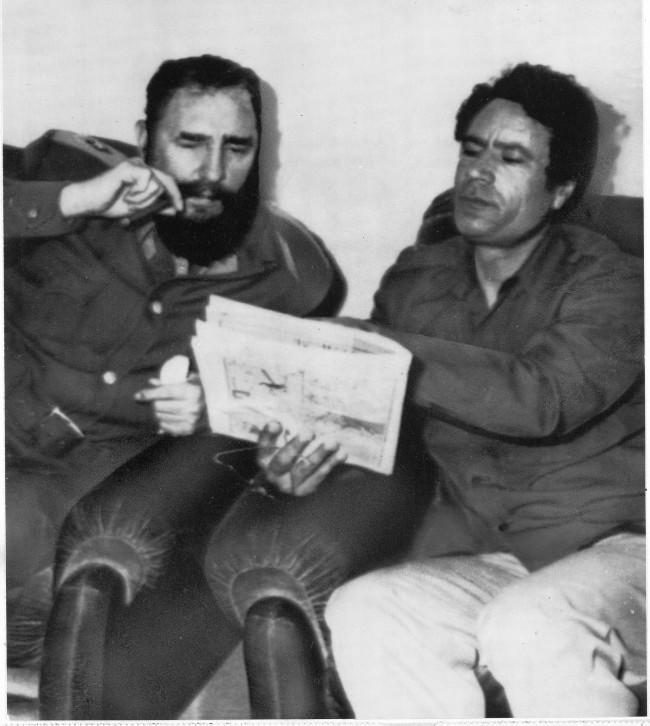 Cuban Prime Minister Fidel Castro, left, and Libyan leader Col. Muammar Gaddafi pore over a document during a meeting of delegates from both their countries in Tripoli. Castro is in Libya as a guest of the country.