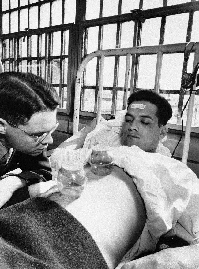 - In this June 25, 1945 picture, an army doctor watches as malaria-carrying mosquitoes bite the stomach of inmate Richard Knickerbockers, serving 10 to 14 years, in the malaria ward at Stateville Penitentiary in Crest Hill, Ill. Around the time of World War II, prisoners were enlisted to help the war effort by participating in studies that could help the troops. A series of malaria studies at Stateville Penitentiary in Illinois and two other penitentiaries were designed to test antimalarial drugs that could help soldiers fighting in the Pacific. Shocking as it may seem, government doctors once thought it was fine to experiment on disabled people and prison inmates.
