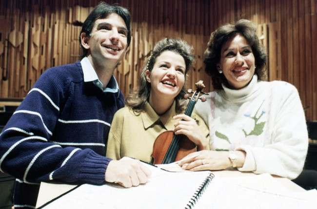 New Zealand soprano Kiri Te Kanawa, right, with German violinist Anne Sophie Mutter and London Symphony Orchestra conductor Michael Tilson Thomas in London, England, United Kingdom, on Sept. 28, 1989, during rehearsals for the orchestra''s 85th anniversary concert. The concert, held in evening at the Barbican in London, was attended by the Princess of Wales