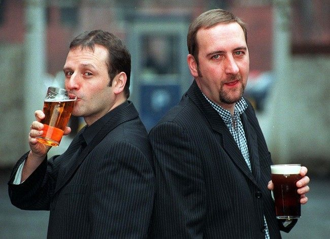 New Radio One Breakfast Show presenter Mark Radcliffe (left) acts the lad as he shares an early pint with his sidekick Marc 'Lard' Riley in Manchester this morning (Thursday). Radcliffe takes over the crucial slot following the controversial termination of Chris Evans' contract earlier this week. Date: 23/01/1997