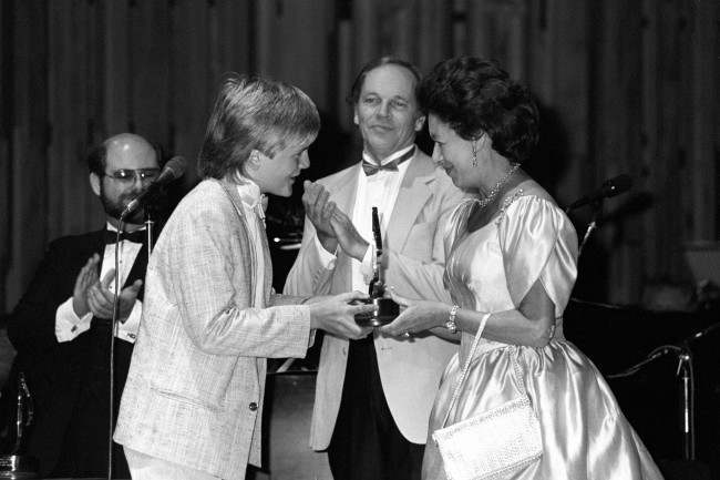 Choir boy Aled Jones receiving his award in the Allmusic Talent of the Year category from Princess Margaret. Watching is John Dankworth, conductor and featured soloist in the concert. Date: 29/09/1986