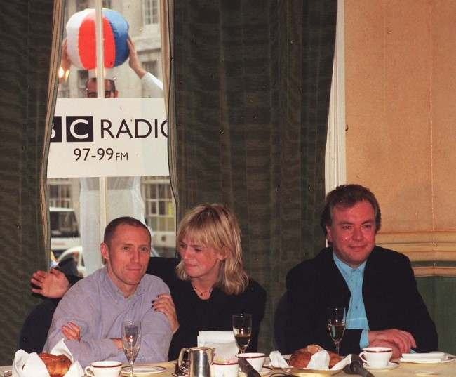 Zoe Ball, 26, is flanked by her co- DJ Kevin Greening (left) and their boss Matthew Bannister during a news conference following their debut broadcast this morning (Monday) for BBC Radio 1. Date: 13/10/1997