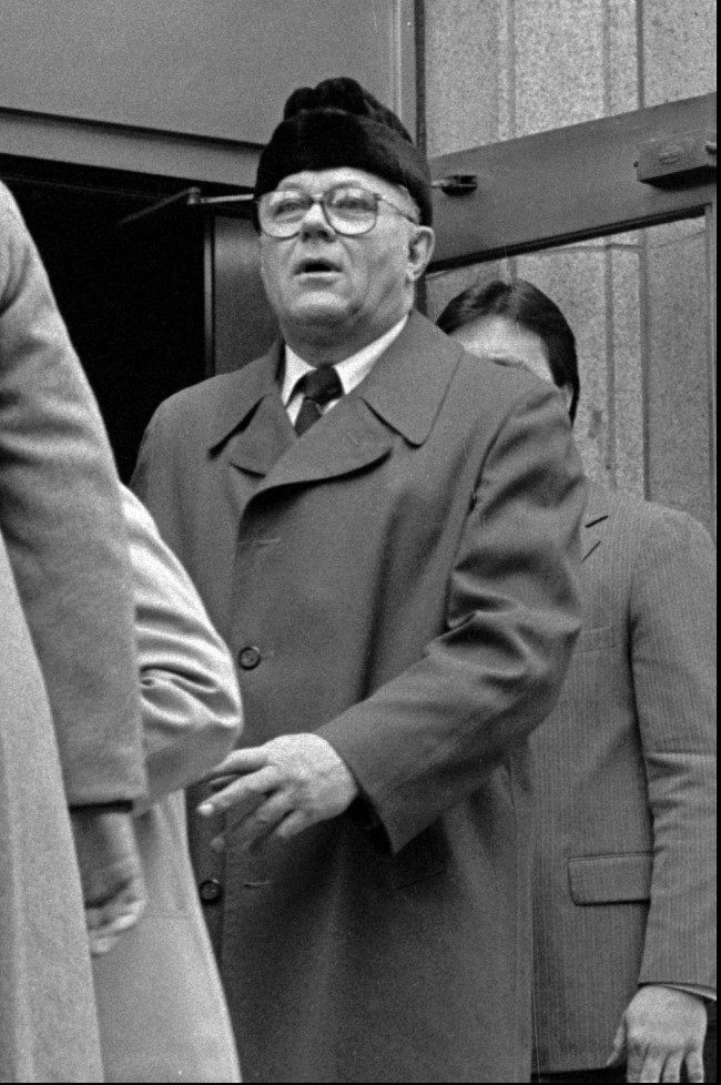 In this 1983 file photo John Demjanjuk, alleged Nazi death camp guard, leaves the federal courthouse in Cleveland. Demjanjuk's U.S. citizenship was stripped from him in 1981. The Ukrainian-born Demjanjuk was a young Soviet army soldier when he was captured in Crimea in 1942 by the Nazis during World War II. Prosecutors say after that he agreed to serve as a guard and trained at the SS Trawniki camp in Poland before being sent to Sobibor. But Demjanjuk says he was held prisoner for most of the rest of the war and never served as a guard in any camp. The defense will continue its closing arguments Wednesday, and a verdict may come as early as Thursday, May 12, 2011.