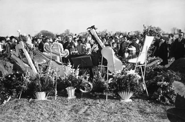 Floral tributes in the shapes of musical instruments, cowboy hats and boots form a backdrop at memorial services in Nashville, Tennessee in March 1963 for four stars of the country music field killed in a plane crash. The entertainers, Patsy Cline, Hawkshaw Hawkins and Cowboy Copas with talent scout Randy Hughes were returning from a benefit performance. Four others in the field have died violent deaths in the past year and half, giving substance to the legend that tragedy, a theme of their music, follows them to their graves.