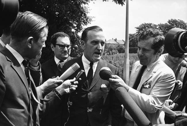Birmingham, Alabama, lawyer Arthur J. Hanes talks with members of the press outside Wandsworth Prison, London on July 5, 1968, after he had conferred with Raymond George Sneyd. British Court had accepted the Federal Bureau of Investigation (F.B.I.) testimony that Sneyd is really James Earl Ray, the man wanted by the State of Tennessee in connection with the slaying of Dr. Martin Luther King. Behind Hanes is George Monygomery of the National Broadcasting Company.