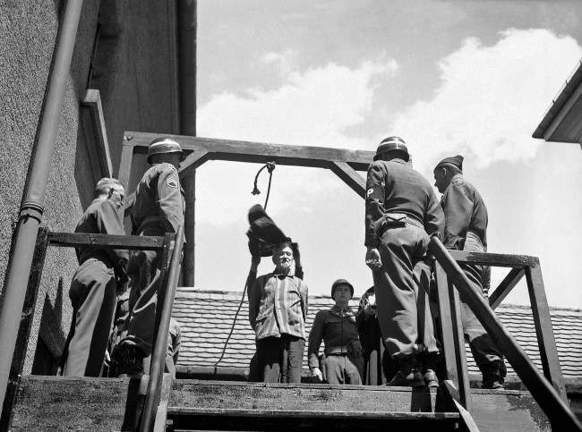 U.S. military authorities prepare to hang Dr. Klaus Karl Schilling, 74, at Landsberg, Germany on May 28, 1946. In a Dachau war crimes trial he was convicted of using 1,200 concentration camp prisoners for malaria experimentation. Thirty died directly from the inoculations and 300 to 400 died later from complications of the disease. His experiments all with unwilling subjects began in 1942.