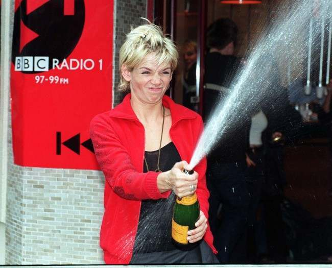 Radio 1 DJ Zoe Ball celebrates with a bottle of champagne during a photocall in London this morning (Monday) after she became the first female DJ to present the BBC Radio 1 Breakfast Show alone. Photo by Michael Stephens/PA. See PA story SHOWBIZ Zoe Date: 28/09/1998