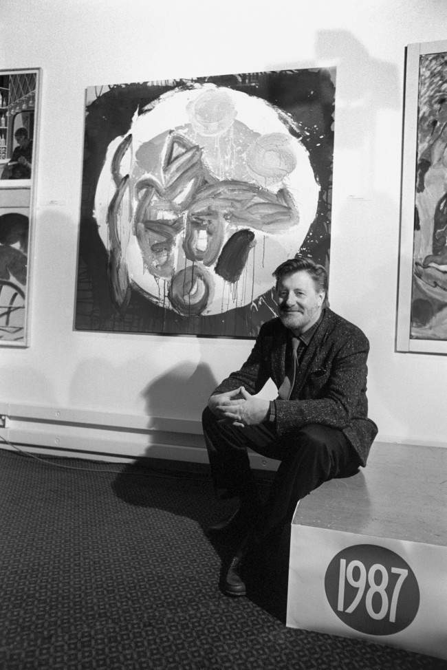 Sheffield-born abstract artist John Hoyand, 53, with his work that won him the Athena Art Award 's top prize of £25,000 at the Awards ceremony at the Barbican Centre in London. Date: 10/02/1987