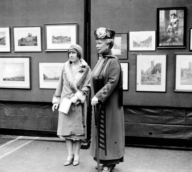 Queen Mary and the Duchess of York (later the Queen Mother) at a Civil Service art exhibition.