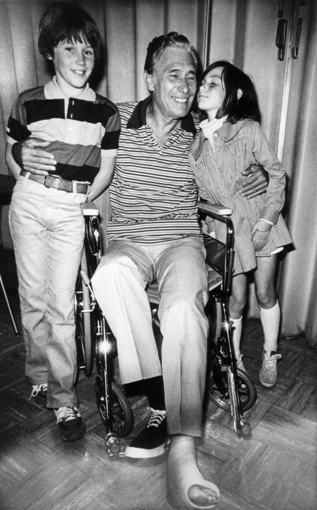 John Combs of Haleiwa, Hawaii, one of the survivors of the Pan Am-KLM crash, hugs his grandchildren after arrival at the University of California-Irvine Medical Center in Anaheim, Calif., March 31, 1977. His foot is in a cast. The children are Sean, 10, and Sabrina, 7. Combs and his wife were among survivors returned to the U.S. from the Canary Islands by military aircraft.