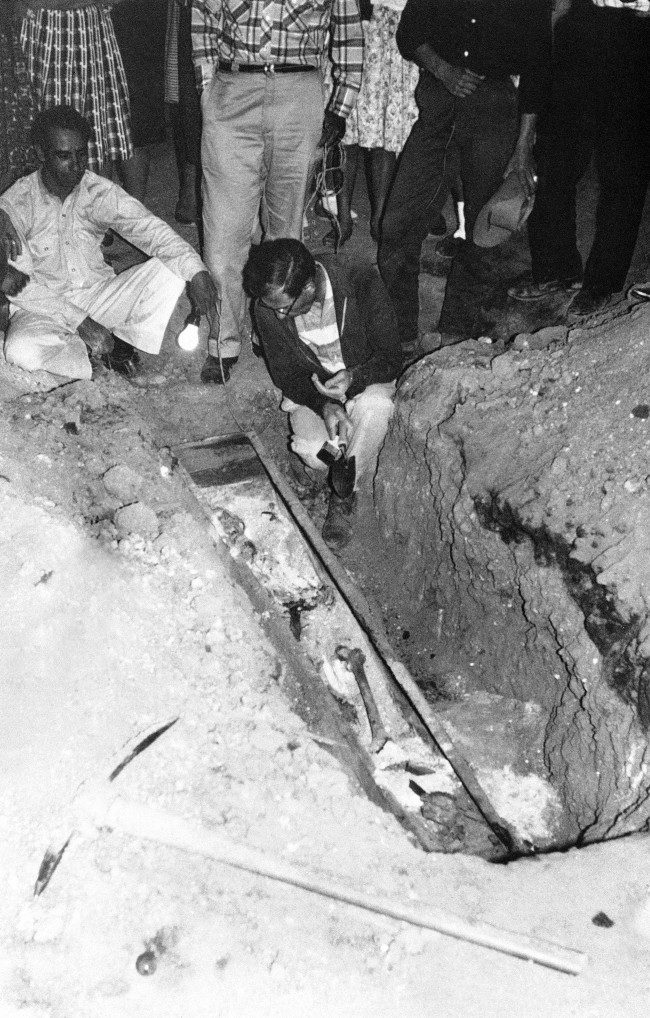 The bones of Juan Bautista de Anza, famed for leading the first Spanish colonists to northern California in 1776 and choosing the site of San Francisco, are identified by a University of California anthropologist in their unmarked grave beneath an ancient church in Mexico, March 3, 1963.