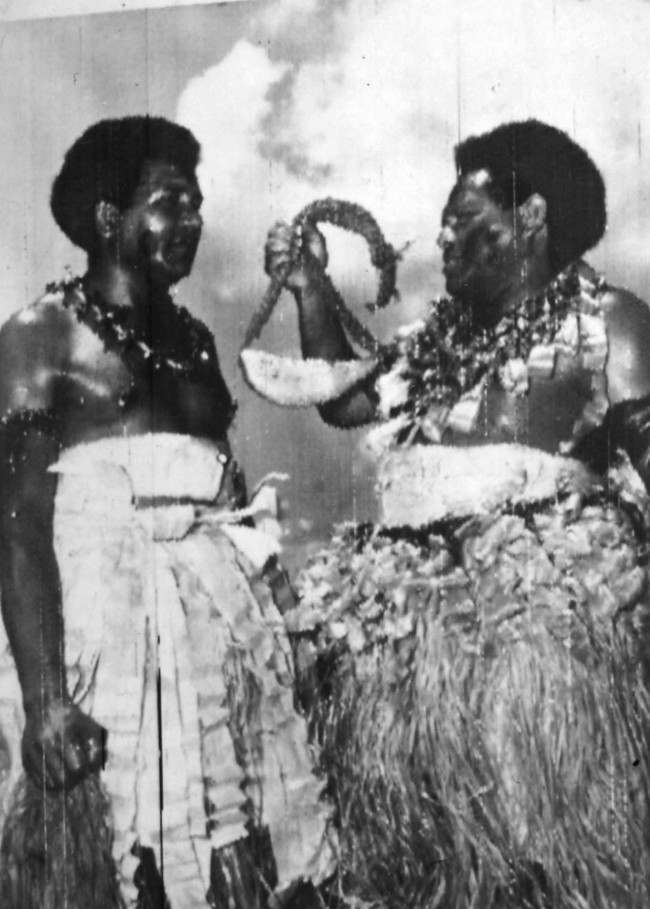 Fiji islanders Alfred Kikau and his brother Henry, with the whale's tooth (tabua) which they brought 80 miles by canoe across the Pacific to Suva to present to the Queen when she visits the islands during her Commonwealth tour. Date: 14/12/1953