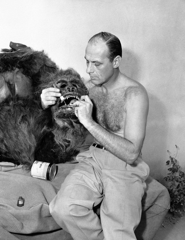 Steve Calvert applies nail polish to the teeth of the gorilla skin he wears for roles in Hollywood movies and TV shows, Nov. 7, 1955. The head is fitted with a mechanical steel frame for opening and closing its mouth. Calvert activates the frame by moving his own jaws.