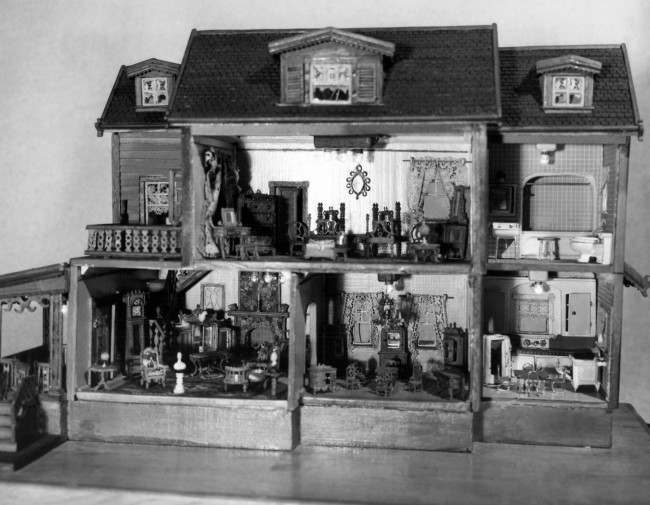 This five-room house and its furnishings were built by Andrew Zenorini of West Englewood, New Jersey shown March 14, 1951. He spent four years building the miniature house and every piece of its furniture and other equipment. It is in style typical of the 1900 period except for the modern kitchen and bath. Although Zenorini and his wife have collected miniature articles for years, he will put only pieces he makes himself into his miniature houses and rooms. The Zenorinis'' daughter is also a collector.