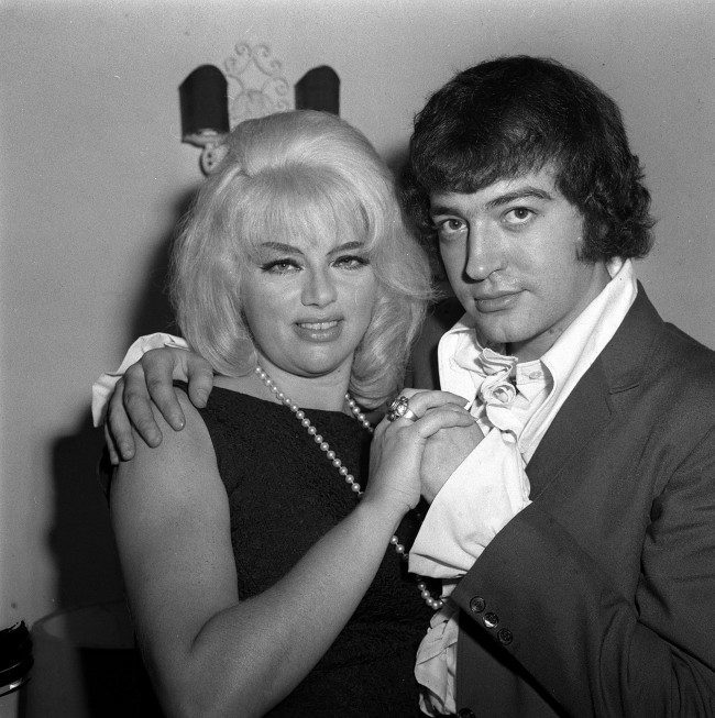 With a large ring on her engagement finger, actress DIANA DORS is pictured in London to-night (Monday) with 27 year old actor ALAN LAKE, from Stoke-on-Trent, whom she is to wed. Ref #: PA.1244660 Date: 28/10/1968