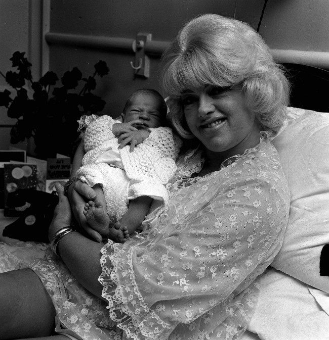British film femme fetale, DIANA DORS, 37 holds her five-day old baby son, JASON LAKE in her bed at a Welbeck Street nursing home in London today (Monday). Diana's third husband, Alan Lake, 28 is the father of Jason. Diana has two other sons, Mark, 10, and Gary, 7. They live in Hollywood with their father Dickie Dawson. Ref #: PA.1244663  Date: 15/09/1969