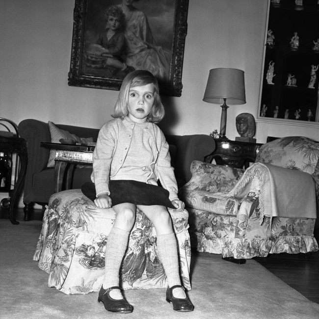 Sitting on a stool, little Princess Elisabeth of Austria, eldest daughter of Archduke Ferdinand and Archduchess Helene von Habsburg-Lothringen, poses on March 8, 1963 at her home in Paris, France. She is going to be one of the bridesmaids at the wedding of Princess Alexandra of Kent to the Honourable Angus Ogilvy on April 24, 1963.