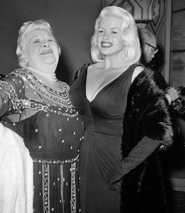 Two stars of two entertainment eras, Sophie Tucker, left, and Jayne Mansfield, meet at the annual awards dinner of the Hollywood Foreign Press Association in Hollywood, March 6, 1959. They were among dozens of stars who turned out to watch presentation of awards for outstanding film performances.