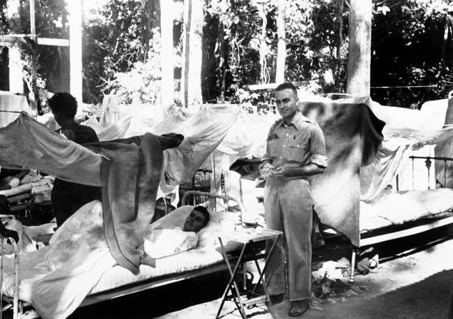Bombing victims lie on beds with mosquito netting in an open-air army hospital in Bataan, Philippines, on April 11, 1942.