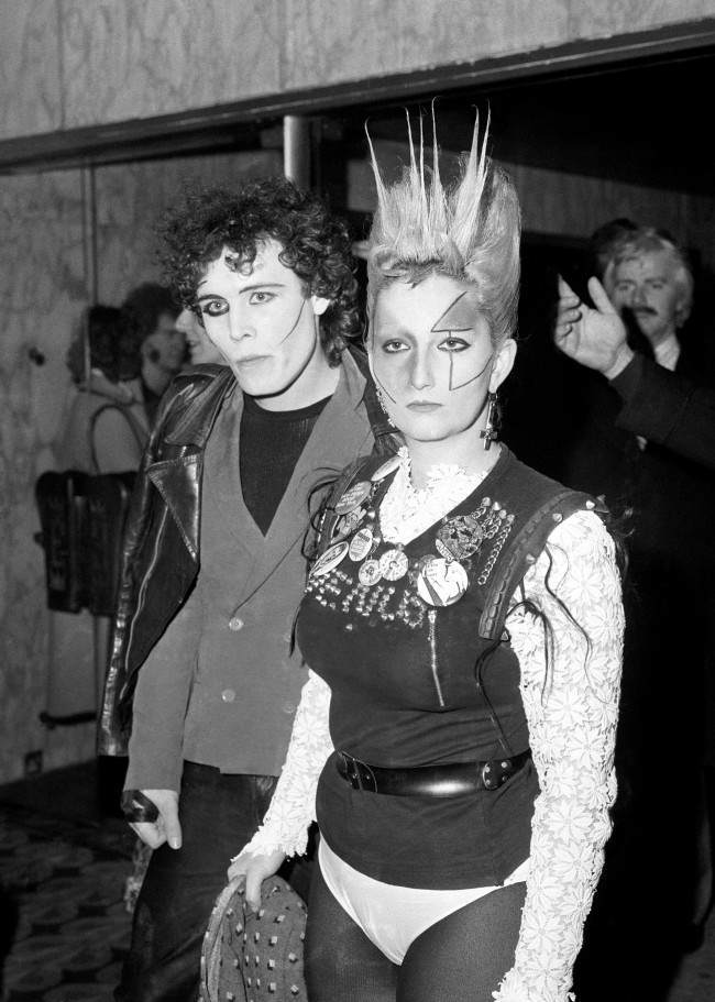 "Punk Rockers Adam Ant and Jordan attending the movie premiere of the John Travolta film, ""Saturday Night Fever"" at the Empire, Leicester Square in London."