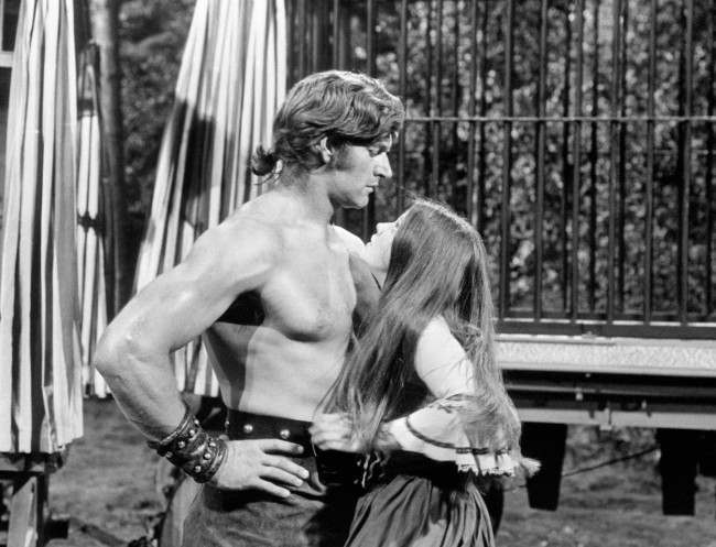 Actor David Prowse and Lynne Frederick performing in a scene from the Hammer film production, Vampire Circus. Date: 14/10/1971