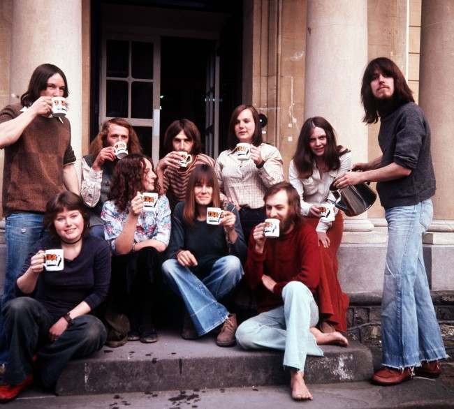 LIVING IN THE PAST: Toasting their return to the 20th century with cups of tea all round are some of the 15 volunteers who have spent a year living in an isolated, authentic Iron Age settlement near Shaftesbury, Dorset. The experiment was initiated by BBC Bristol.