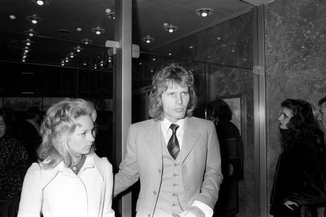 BBC Radio DJ Johnnie Walker with guest arriving at the Warner West End Theatre to attend the premiere of the film Performance starring James Fox and Mick Jagger. The woman in the picture could be wife/girlfriend Frances Kum whom he married in 1971 but needs to be confirmed