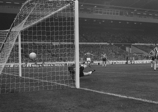 Dennis Tueart scores Manchester City's second goal at Wembley. Goals by Peter Barnes and Tueart gave City their second League Cup final win in six years, when they beat Newcastle United 2-1.