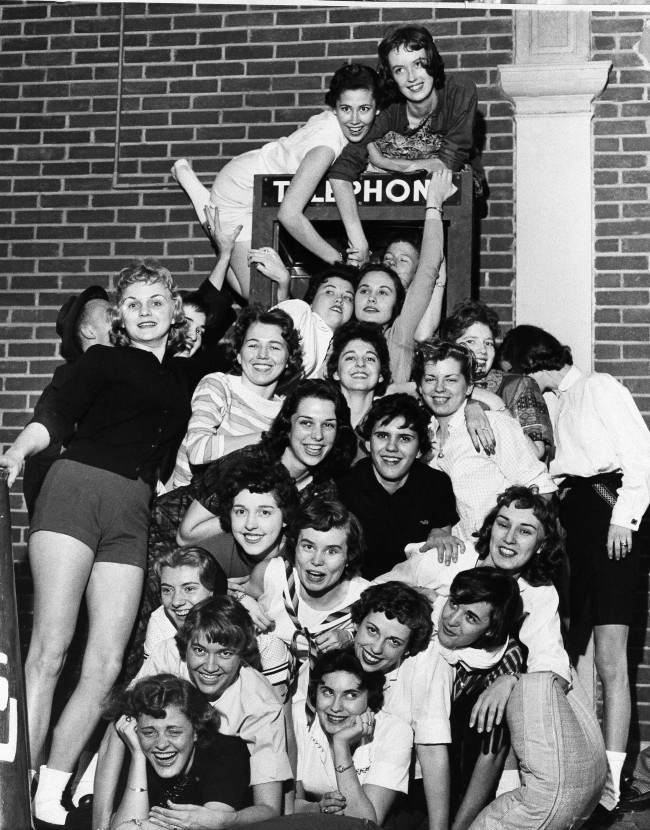 26 coeds from Memphis State University, members of the Sigma Kappa Sorority proclaimed themselves world champions, April 1,1959 to day in the art of stuffing a telephone booth at Memphis. A spokesman for the girls said since they had neither seen nor heard of prior female stuffed telephone booths they were proclaminig the championship.
