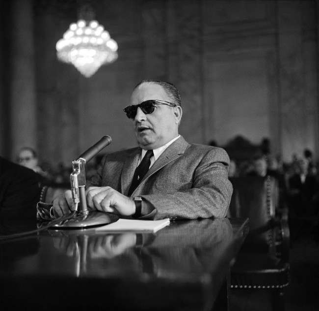 Carlos Marcello, alleged baron of the New Orleans underworld, shown as he appeared before the Senate Rackets Committee, March 23, 1959, Washington, D.C. Marcello invoked the Fifth Amendment 35 times in 15 minutes in refusing to answer questions about his occupation, sources of income and associations.