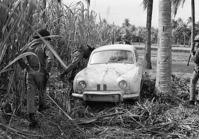South Vietnamese troops inspect the abandoned Renault Dauphine of missing French journalist Michele Ray, discovered near Ngoc An on Jan. 22, 1967. Ray was released by her Viet Cong captors about two weeks later.