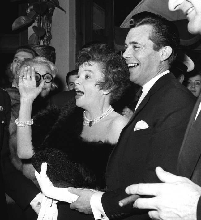 Actress, Judy Garland and her co star Dirk Bogarde arrive at the Plaze cinema, Piccadilly Circus, London for the premiere of their film, 'I Could Go On Singing'.