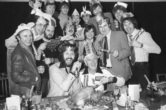 A group of fifteen of radio's best-known disc jockeys eating Christmas Lunch at Broadcasting House. Back L/R Simon Bates, Mike Read, Peter Powell, Tommy Vance, Adrian Love and Richard Skinner. Middle L/R Paul Burnett, Andy Peebles, John Peel, Steve Wright, Annie Nightingale, Paul Gambaccini, and Adrian Juste. Front L/R Dave Lee Travis and Jimmy Savile. Date: 04/12/1980