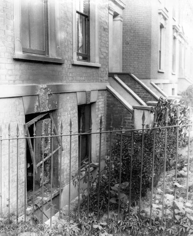 The basement windows of a bombed house following a zeppelin raid, from which a woman and baby escaped. Date: 01/01/1915