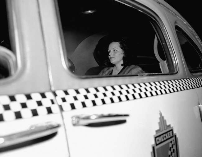 Virginia Hill Hauser, one-time girl friend of the late Bugsy Siegel, departs by cab from Federal Courthouse in New York City, March 15, 1951 after her appearance before interstate crime hearings of the Kefauver Senate Crime Investigating Committee. Wearing a picture hat and silver blue mink cape, she told the probers that ìthe only money I ever made I reported on my taxes.î She said the incomes stated in her tax return represented earnings from wagers on sporting events.