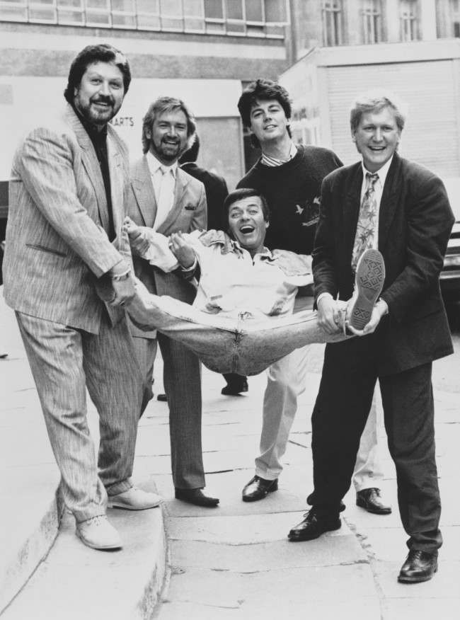 BBC Radio One Breakfast Show DJ Mike Smith (right) is joined by former presenters of the early-morning slot as the network celebrates its 20th anniversary. From left: Dave Lee Travis, Noel Edmonds, Tony Blackburn and Mike Read. Date: 30/09/1987