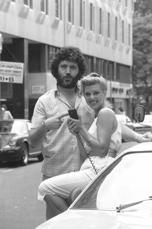 BBC Radio One DJ Dave Lee Travis poses with model Nicky Giles, 23, to promote the first CB radios in Britain, which were demonstrated by Fidelity Radio at the Eyeball Bistro Club in London. Date: 20/08/1981